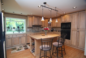 by: Vern Uyetake, Norm and Kathy Weseloh of Lake Oswego worked with Oswego Design & Remodeling to transform a dreary 1969 kitchen into something classic, yet functional, for today. Just two weeks after completion, Kathy said she can't stop baking cookies, and Norm enjoys doing the dishes.