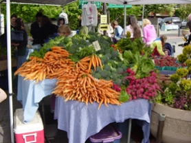 by: , Fresh produce was just one of the many offerings that drew people to the Lake Oswego Farmer's Market.