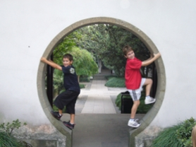 by: Submitted Photo, Owen, left, and Jack Kessel didn't just get a great education in China. They had fun, too. Here the brothers provide a good photo opp in Hangzhou at Emperor Qian's Temple.