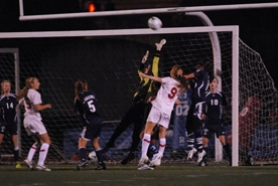 by: Vern Uyetake, Lake Oswego goalkeeper Kat Colson, left, tries to ensure that a header from Lincoln's Caroline Kreuz won't find its way into the net during Tuesday night's state quarterfinal game. Kreuz wound up missing this shot but she later scored on a header to help the Cardinals to a 3-1 victory. Below, Lake Oswego's Katrin Krebs battles Lincoln's Aysa Williams for possession near midfield.