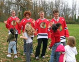 "by: SUBMITTED PHOTO, Hockey players from the Portland Winter Hawks team, from left, Scott Gabriel, Viktor Sjodin, Ryan Kerr and Jake Dietrich high-five students at Oak Creek Elementary during a visit to the school last week as part of the ""The Shuffle to Buffalo"" program."