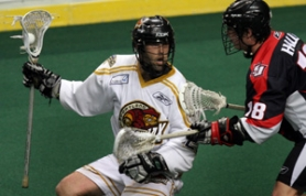 by: JIM CLARK, n a game earlier this year, Ryan Powell of the LumberJax (left) thwarts San Jose's Darren Halls. A lacrosse fan writes to say he hopes more coverage will come as the team resurrects its season.