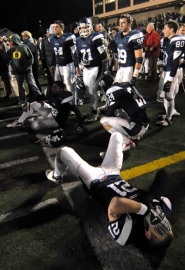 by: Vern Uyetake, Lake Oswego's AJ Kingsbury and his teamates were in tears after the Sheldon defense blocked the Laker's extra point attempt in overtime, ending Lake Oswego's state championship bid and season with an 11-1 record.