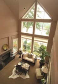 by: Vern Uyetake, The Best's living room overlooks Oswego Lake and incorporates different prints, textures and colors.