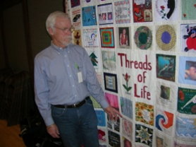 by: Cliff Newell, Bob Dexter of Lake Oswego, a volunteer for Donate Life Northwest, stands by a quilt with patches from organ donors and recipients. Dexter was a busy man this week, lining up people for the organization's new online registry.