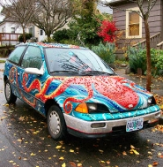 "by: Rita A. Leonard, This ""octopod"" Art Car was painted by Sellwood resident Emily Hall, president of the Portland Art Car Revival Club."