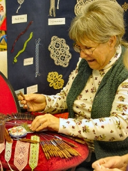 by: Merry MacKinnon, CJ David, and other members of the Portland Lace Society, demonstrated lace-making at Sellwood Community Center during its Snowflakes Holiday Bazaar on December 1st.