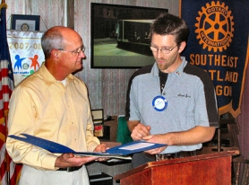 by: Eric Norberg, Joel Fields, owner of Sellwood's UPS Store, left, was inducted into membership of the Southeast Portland Rotary Club by its membership chairman, Eric Smrkovsky, of Atiyeh Carpet Cleaning, on Monday, November 12th.