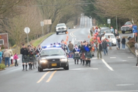 by: Vern Uyetake, West Linn police and bagpipers lead off  the annual Christmas  parade down Willamette Falls Drive.