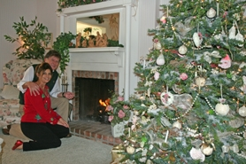 by: Gail Park, Jacque and Daniel Quello relax in front of the fire and enjoy the Victorian tree that Daniel decorates.