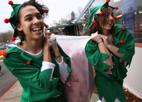 by: Jaime Valdez, Westview's Ashley Williams and Delaney Burns help haul in bags filled with toys last week.