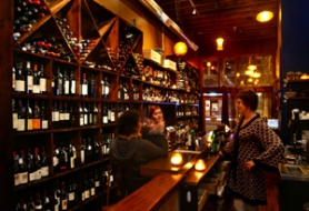 by: L.E. BASKOW, In a cozy space lined with lots of bottles, Amanda Prock runs the bar at Lupa, where wine education comes easy.