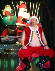 by: KATIE HARTLEY, Mark Brown, Mr. Oregon Bear 2007, plays Santa, giving lap time to the naughty and nice at the Bears-sponsored Community Holiday Show.