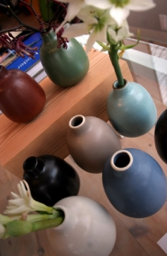 by: JIM CLARK, Canoe's buyers often stock the shop by visiting stores and manufacturers abroad, bringing back items that complement U.S.-made goods such as Heath's handsome bud vases.