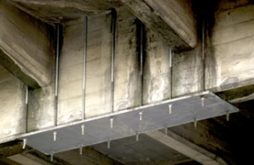 by: Jim Clark, The Sellwood Bridge has numerous of these metal braces keeping the concrete intact for the time being.