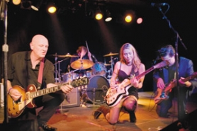 "by: Contributed photo, The Strange Tones kneel at the altar of rockin' blues music as they get down and do their thing on stage. The four-piece band has earned critical raves and recently released its third CD ""We're On Our Way."""