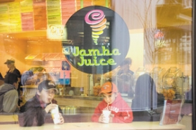 by: John Klicker, From left, Jasao Longoria,  10, and his brother, Antonio, 5, enjoy juice drinks at Jamba Juice, as a line of customers wait Saturday, Dec. 22. The store opened in the Wood Village Town Center Dec. 20.