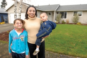 by: Carole Archer, Carolyn Williams, with her daughter, Evelina, 10, and son, Diego, 2, stand in front of the $230,000 home she bought in Gresham with advice and help from the Portland Housing Project.