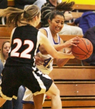 by: Tommy Whitcomb, Banks guard Patricia Fellas gets harassed during last Wednesday's game against Gladstone. The Lady Braves traveled to Amity on Friday but lost in the first round of a holiday tournament to Santiam Christian.