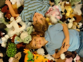 by: , Carson and Conner Terry are surrounded by Webkinz toys, which they recently donated to the Ronald McDonald House. They bought the Webkinz with money they received from friends in lieu of birthday presents.