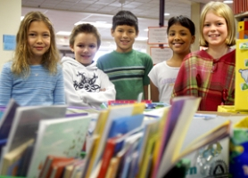 by: Jonathan House, FLOOD RELIEF — Jacob Wismer Elementary thirdgraders including, from left, Annelis Voldengen, Caleb Clark, Eric Patterson, Ajitha Mallidi and Abbie Young, donate books to those whose homes and schools were destroyed by floods in Vernonia.