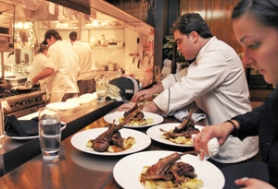 by: JIM CLARK, Chef Jack Yoss (right, in white) keeps the food coming on a busy night at Ten 01.