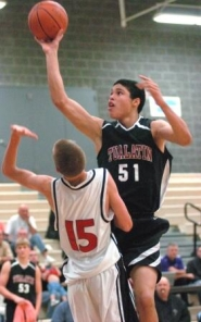 by: DAN BROOD, UP FOR TWO — Tualatin junior Anthony Freeman (51) shoots over North Medford's Danny Berger.