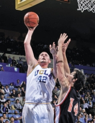by: STEPHEN DUNN, Lake Oswego product Kevin Love, now a Bruin, shoots over Idaho State's Lucas Steijn earlier this month. Love's the top scorer for UCLA.