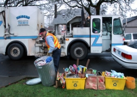 by: JIM CLARK, Hauler Chuckie Ferris picks up garbage in the Westmoreland neighborhood the day after Christmas. Changes are coming that will mean more curbside recycling for Portland residents — and slightly higher trash pickup rates.