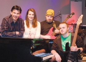 by: Carole Archer, Pastor Milt Buckelew, left, his daughter, Lacey Ferguson, Wade Crain and Darren Rice belong to The Chapel's Renegade Worship Band in Troutdale. The group plays contemporary Christian music both at the church and at various area venues.