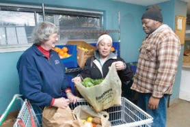 by: Carole Archer, From left, Diane Sherwin assists Linda and Roosevelt Clark, of Troutdale, pick out fresh produce at Snow-CAP Community Charities on Friday, Dec. 28. Sherwin was presented with the 2007 Lowenstein Trust award for her work with the underprivileged.