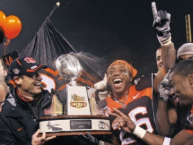 by: Jed Jacobsohn, Coach Mike Riley (left), tailback Yvenson Bernard (right) and the Oregon State Beavers celebrate their Emerald Bowl win Friday night. The Beavers have won their last four bowl appearances.