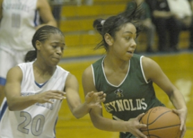by: David Ball, Reynolds guard Shawnelle Campbell rips the ball away from a Grant defender during the Raiders' 36-33 win Friday night.
