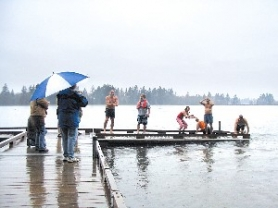 by: File photo, About 30 people braved January temperatures to dive into Roslyn Lake during last year's Polar Bear Dip.