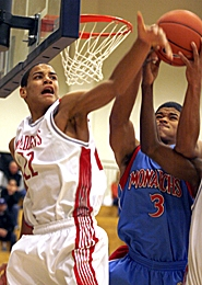 by: JONATHAN HOUSE, GET AFTER IT — Westview's Garrett Jackson (left) fights for a rebound with Mark Morris' Jeray Key during the Wildcats' win at the Les Schwab Invitational.