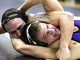 by: MILES VANCE, WRAPPED UP – Aloha's Jared Dunivan (left) puts the squeeze on Sunset's Joel Harrison en route to his second-round pin in their match at 171 pounds last Wednesday night at Sunset High School.