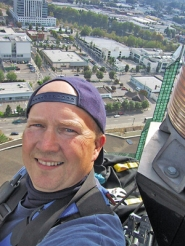 by: COURTESY OF WHITE GLOVE BUILDING MAINTENANCE, Washing the windows on the Oregon Convention Center towers can be tricky, says Mike Williams of White Glove Building Maintenance, which tends to them once or twice a year. Window washers must be comfortable with heights, he says, but he doesn't hire daredevils.