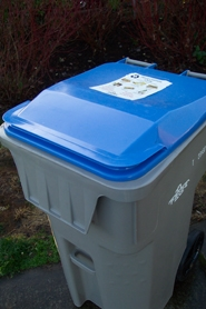 by: Bob Schoenberg, A new 95-gallon cart for co-mingled recylable material.