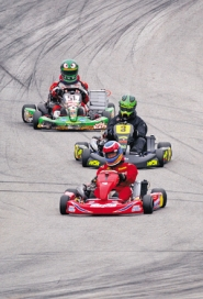 by: COURTESY OF EMILY RODENROTH, Scott Holmboe (front), Chris Hegar (middle) and a third unidentified driver hit the track. Recently, Holmboe and Hegar traveled to the East Coast for the annual U.S. Kart Grand Prix.