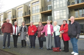 by: John Klicker, From left, John Andrew, Margaret Maggy, Dorothy Stone, Maggie Splawn, Muriel Morgan, Pauline Ellis, Louise Dix, Betty Chaney and Liz Bartholomew line up in front of the Beranger building in downtown Gresham.