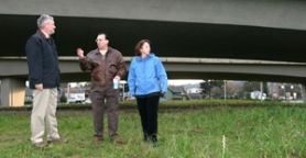 "by: JIM CLARK, Metro Councilor Robert Liberty (left) meets with Dewey Akers, president of the Lents Neighborhood Association, and Sue Lewis of the Portland Development Commission on the site under Interstate 205 that could become the visual ""gateway"" to the neighborhood."