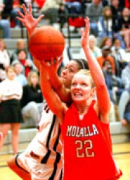 by: ROLAND SIMMONS, Gladstone's Shanoaleigh Roseby, left, battles Molalla's Erica Filipetti for a rebound.