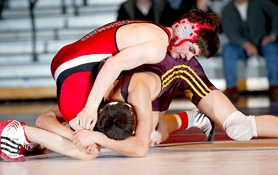 by: ROLAND SIMMONS, Oregon City freshman 125-pound wrestler Robert Brown, top, gave the Pioneers a boost last week when he earned a 7-3 decision over Milwaukie senior Donovan Nhoung.