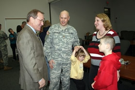 by: submitted photo, Governor Ted Kulongoski, left, speaks with Oregon National Guard Major Eric Wunderlich and his family during last week's ceremony.