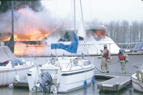 by: , Crews from Columbia River Fire and Rescue battle a boat blaze that consumed a 45-foot vessel moored at St. Helens Marina on River Street. No injuries were 