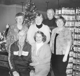 by: Kari Hastings, Finger food contest winners gathered at the Troutdale General Store for lunch on Wednesday, Jan. 2. In the top row, from left, are Ruth Vandenbos, Mary Lynn and Jim Sutton and Imogene Wilner. In the bottom row are Bob and Katherine Horswell.