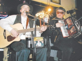 by: Contributed photo, Scott Messer, left, and Ken Andresen have been playing Celtic music together for more than a decade and have released a number of albums as part of Darby O'Gill.