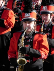 by: submitted photo, Junior Cydney Tyler plays her saxophone as the Oregon City Marching Band marches in the Holiday Bowl parade in San Diego on Dec. 27. The band won a host of awards at the event. See story on page A7.