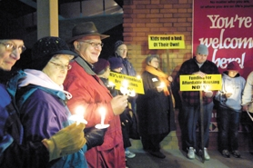 by: John Lariviere, Forest Grove's Eric Canon (third from left) speaks on issues facing the homeless during a candlelight vigil Saturday.