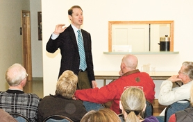 by: Rick Swart, Ron Wyden speaks to a group of Vernonia residents about flood recovery during a town hall meeting last Friday. He promised more aid for the besieged town.